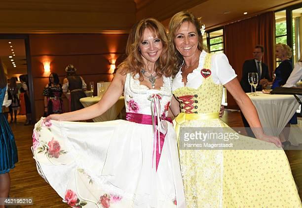 Cornelia Corba and Gundis Zambo attends the Sixt ladies dirndl dinner on July 15 2014 in Munich Germany