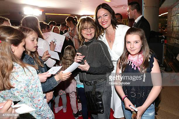 Cornelia Froboess Nina Kronjaeger and fans during the German premiere of the film 'Ostwind 2' on May 3 2015 in Munich Germany