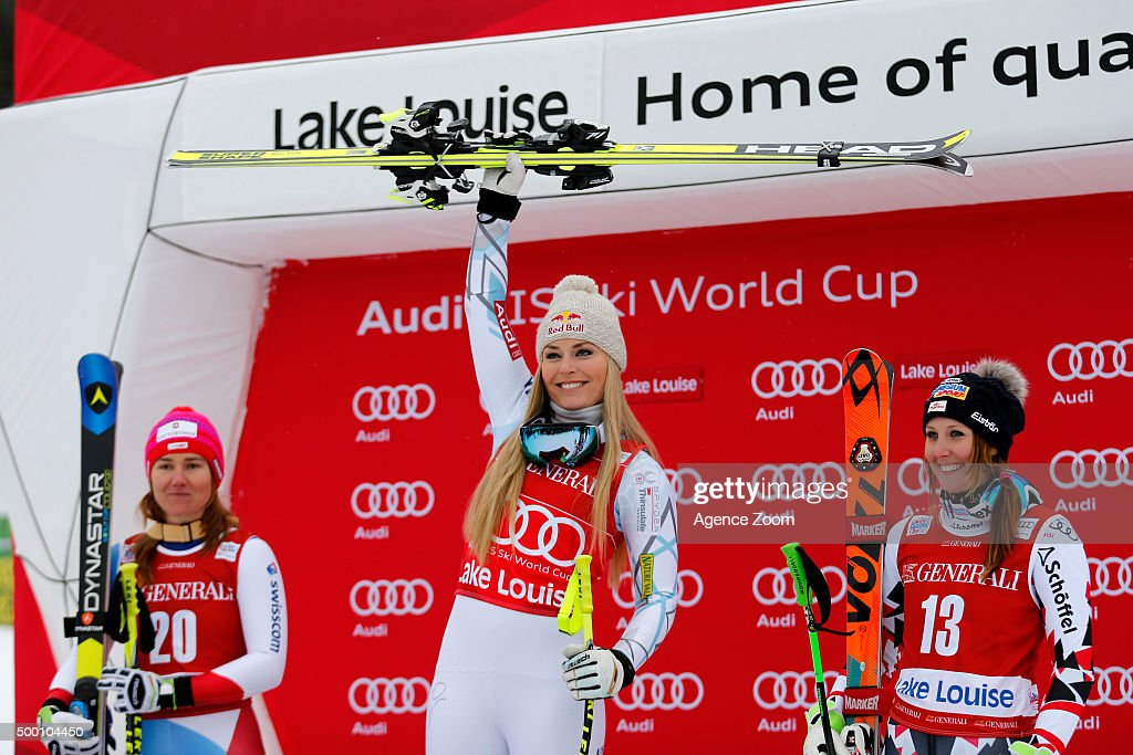 Cornelia Huetter of Austria takes 3rd place, Lindsey Vonn of the USA takes 1st place, Fabienne Suter of Switzerland takes 2nd place during the Audi FIS Alpine Ski World Cup Women's Downhill on December 05, 2015 in Lake Louise, Canada.