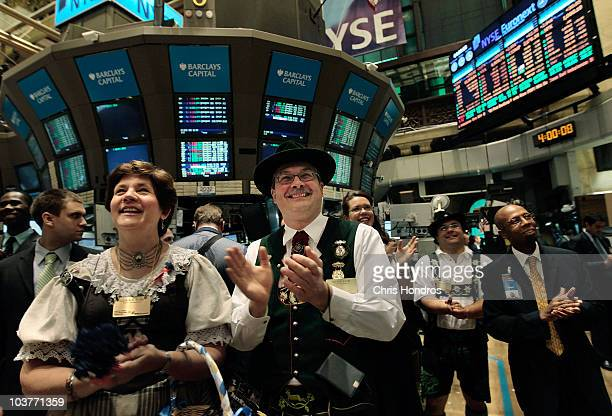 Cornelia Rom and her husband Richard Rom applaud the closing bell on the floor of the New York Stock Exchange September 1 2010 in New York City...
