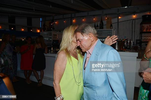 Cornelia Sharpe Bregman and Ted Hartley at NYC Mission Society Cocktails and Conversations in Southampton at OREYA Hamptons on August 25, 2016 in...