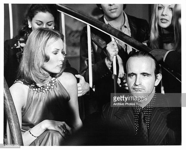 Cornelia Sharpe looking down on Peter Boyle on a staircase in a scene from the film 'Crazy Joe' 1974