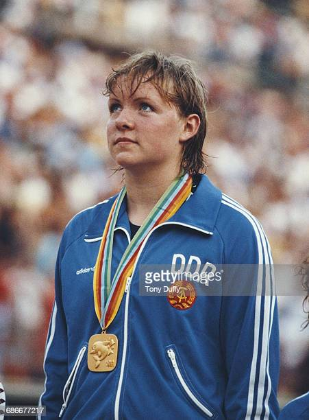 Cornelia Sirch of the German Democratic Republic on the podium with her gold medal after winning the Women's 200 metres Backstroke at the European...