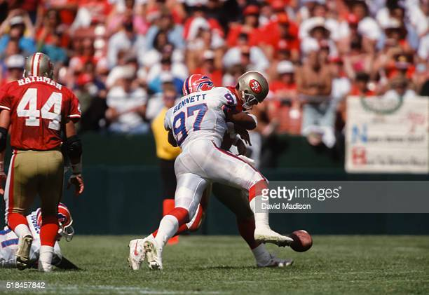 Cornelius Bennett of the Buffalo Bills hits Steve Young of the San Francisco 49ers and causes a fumble during a National Football League game between...