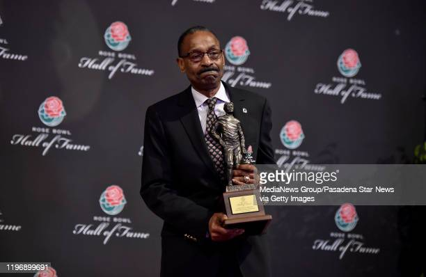 Cornelius Green holds his hall of fame trophy after being inducted along with Matt Leniart Eddie Casey and Jacque Robinson during the Hall of Fame...
