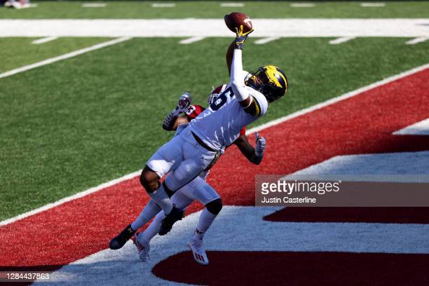 Cornelius Johnson of the Michigan Wolverines catches a touchdown pass during the first quarter against the Indiana Hoosiers at Memorial Stadium on...