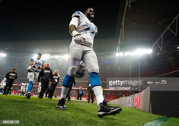 Cornelius Lucas of Detroit Lions leaves the field of play at the end of the game during the NFL game between Kansas City Chiefs and Detroit Lions at...