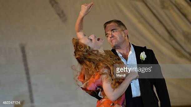 Cornelius Obonya and Brigitte Hobmeier are seen during the photo rehearsal of 'Jedermann' on the Domplatz ahead of Salzburg Festival 2014 on July 16,...