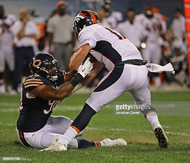 Cornelius Washington of the Chicago Bears sacks Paxton Lynch of the Denver Broncos at Soldier Field on August 11 2016 in Chicago Illinois The Broncos...