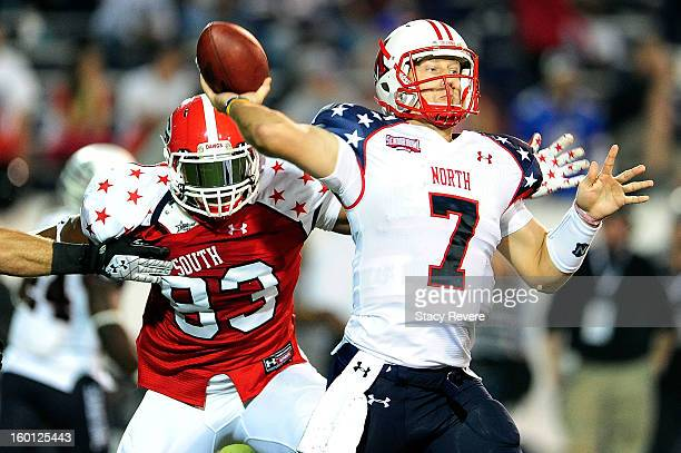 Cornelius Washington of the South squad pressures Zac Dysert of the North squad during the Senior Bowl at Ladd Peebles Stadium on January 26 2013 in...