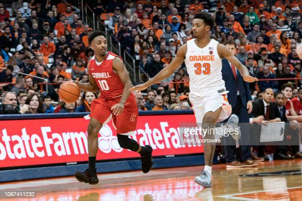Cornell Big Red Guard Matt Morgan dribbles the ball with Syracuse Orange Forward Elijah Hughes defending during the first half of the Cornell Big Red...