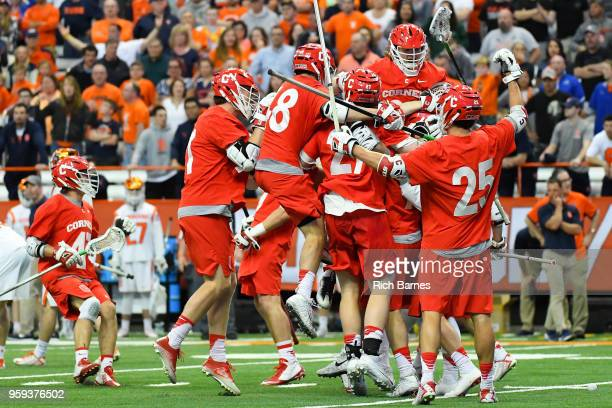 Cornell Big Red players celebrate following a 2018 NCAA Division I Men's Lacrosse Championship First Round game against the Syracuse Orange at the...