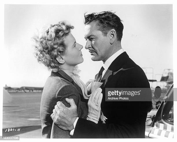Cornell Borchers is embraced by Errol Flynn in a scene from the film 'Istanbul', 1957.
