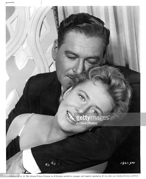 Cornell Borchers is held by Errol Flynn in publicity portrait for the film 'Istanbul', 1957.