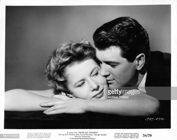 Cornell Borchers is kissed by Rock Hudson in publicity portrait for the film 'Never Say Goodbye', 1959.