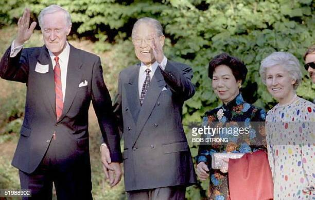 Cornell University President Frank HT Rhodes and Taiwan's President Lee TengHui wave to members of the media as they enter a dinner in honor of the...