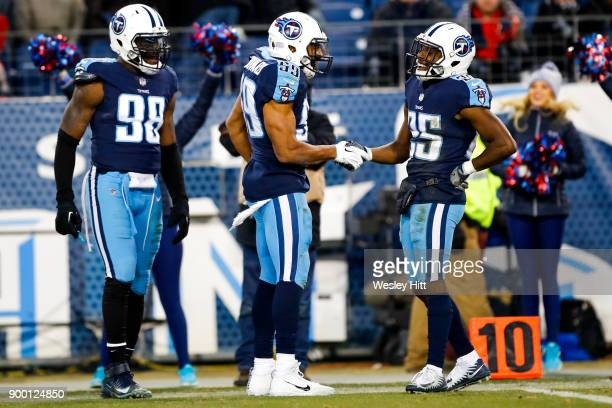 Corner Back Adoree' Jackson celebrates with Linebacker Wesley Woodyard of the Tennessee Titans after a forced fumble by Jackson at Nissan Stadium on...