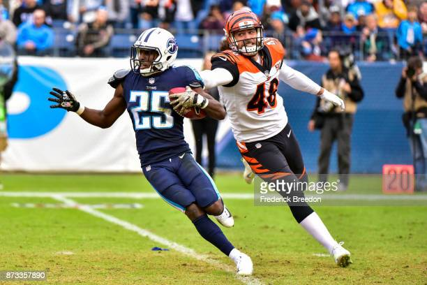 Corner Back Adoree' Jackson of the Tennessee Titans carries the ball against Long Snapper Clark Harris of the Cincinnati Bengals at Nissan Stadium on...