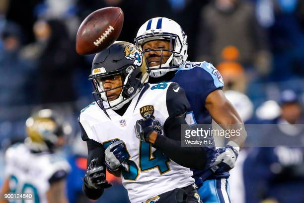 Corner Back Adoree' Jackson of the Tennessee Titans forces Wide Receiver Keelan Cole of the Jacksonville Jaguars to fumble the fall at Nissan Stadium...
