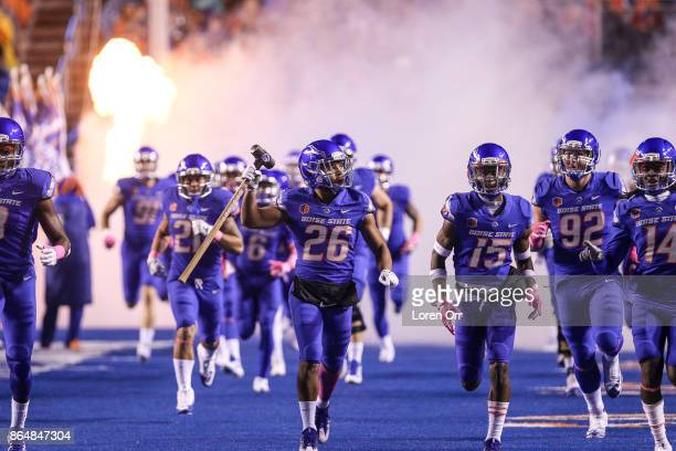 Corner back Avery Williams of the Boise State Broncos leads his team onto the field prior to the start of first half action between the Wyoming...
