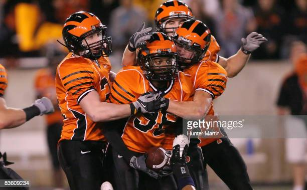 Corner back Barry Newell of the Princeton Tigers celebrates his interception with teammates during the game against the Pennsylvania Quakers on...