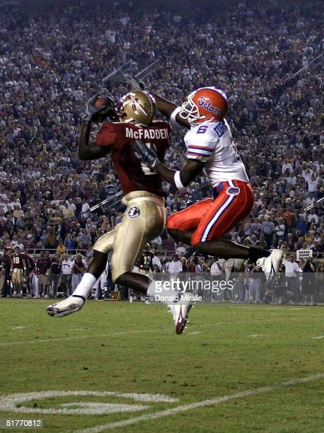Corner back Bryant McFadden of the Florida State Seminoles makes an interception against wide receiver Jermalle Cornelius of the University of...