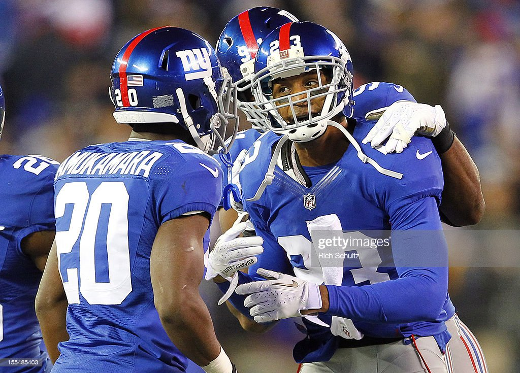 Corner back Corey Webster #23 of the New York Giants is congratulated by teammates Prince Amukamara #20 and Justin Tuck #91 after intercepting a pass in the second half against the Pittsburgh Steelers during an NFL game at MetLife Stadium on November 4, 2012 in East Rutherford, New Jersey. The Steelers defeated the Giants 24-20.