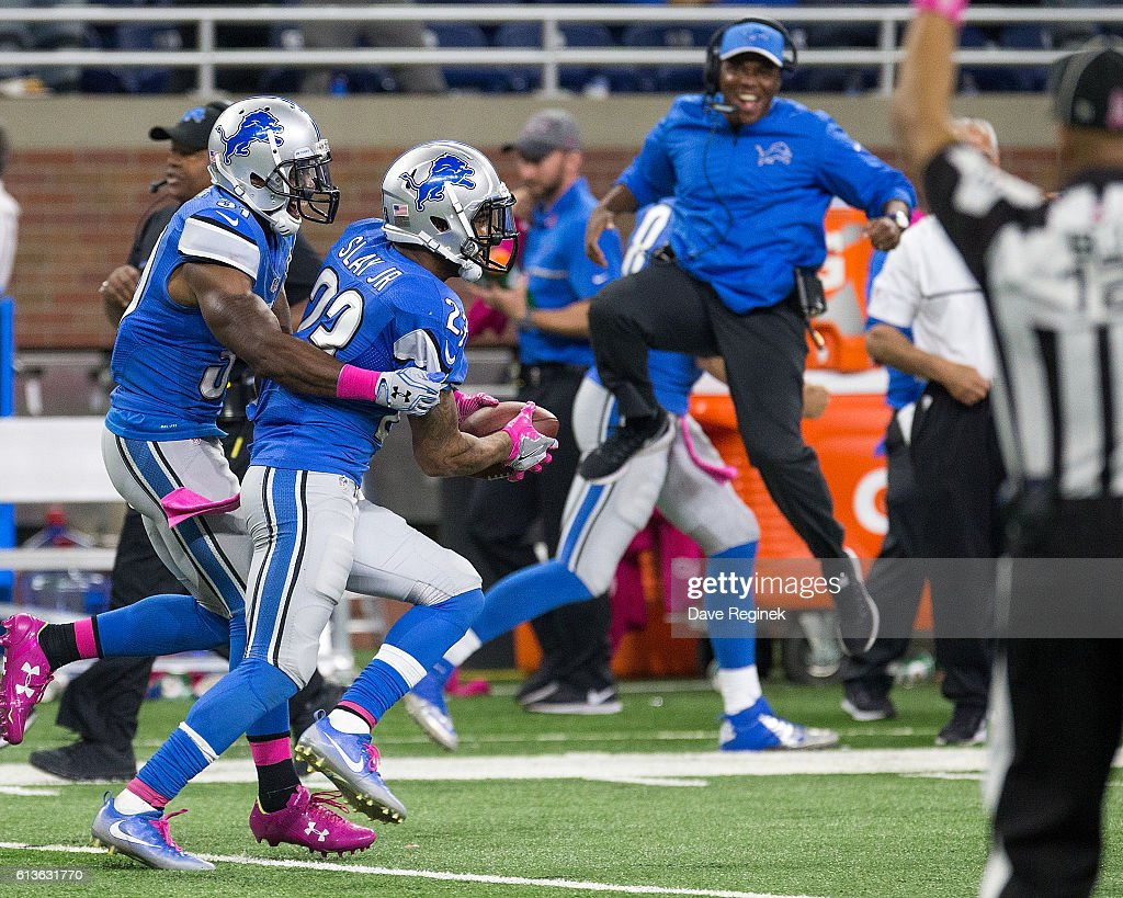Corner back Darius Slay #23 of the Detroit Lions celebrates his interception with teammate safety Rafael Bush #31 as the sideline explodes during the final minutes of an NFL game against the Philadelphia Eagles at Ford Field on October 9, 2016 in Detroit, Michigan. The Lions defeated the Eagles 24-23.