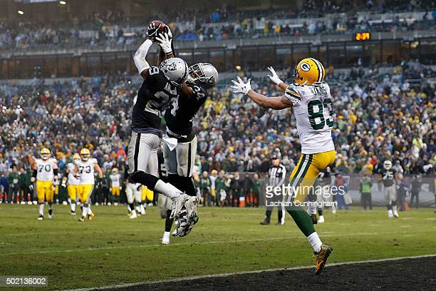 Corner Back David Amerson of the Oakland Raiders intercepts a pass thrown by Quarterback Aaron Rodgers of the Green Bay Packers in the fourth quarter...