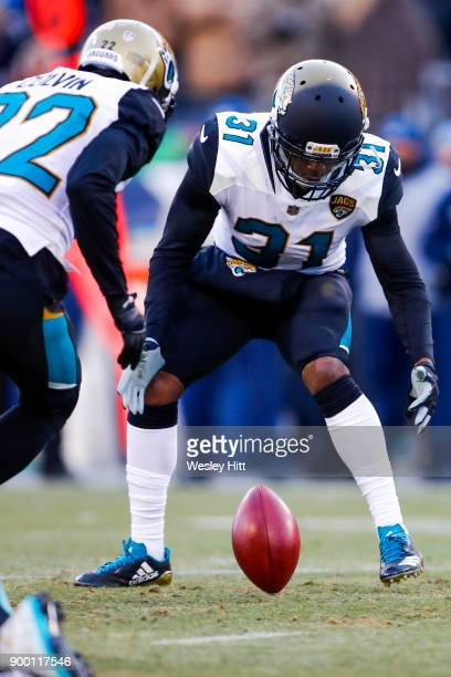 Corner Back Jalen Myrick and Corner Back Aaron Colvin of the Jacksonville Jaguars looks to recover a blocked kick against the Tennessee Titans at...