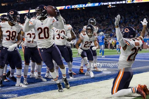 Corner back Kyle Fuller of the Chicago Bears celebrates his interception in the fourth quarter with other teammates of the defense during an NFL game...