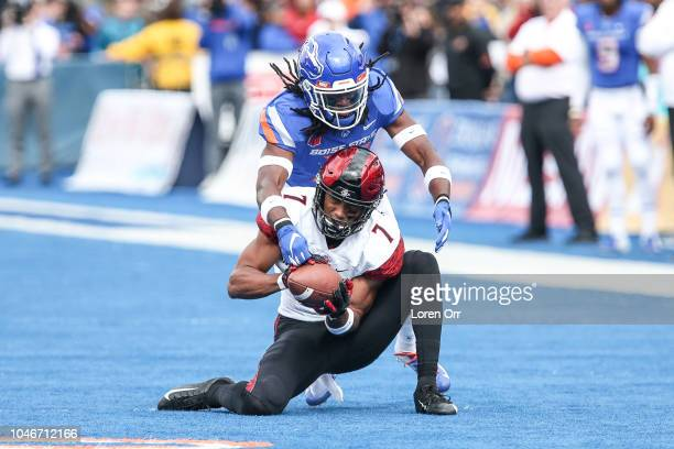 Corner back Tyler Horton of the Boise State Broncos knocks the ball away from wide receiver Fred Trevillion of the San Diego State Aztecs during...