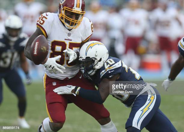 Corner Desmond King of the Los Angeles Chargers knocks the ball loose for an incomplete pass from tight end Vernon Davis of the Washington Redskins...