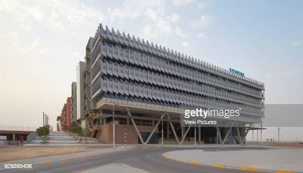 Corner elevation from approach. Siemens Masdar, Abu Dhabi, United Arab Emirates. Architect: Sheppard Robson, 2014.