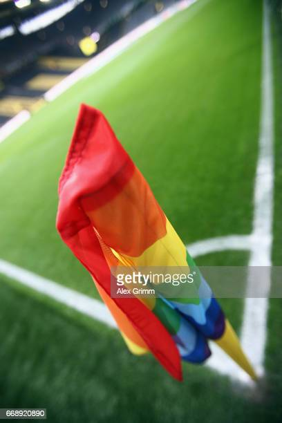 A corner flag is seen in the rainbow colours to protest against homophobia during the Bundesliga match between Borussia Dortmund and Eintracht...