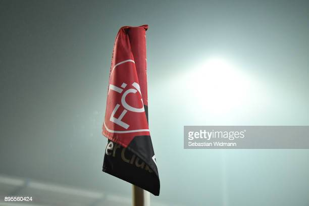 A corner flag with the logo of 1FC Nuernberg is seen prior to the DFB Cup match between 1 FC Nuernberg and VfL Wolfsburg at MaxMorlockStadion on...