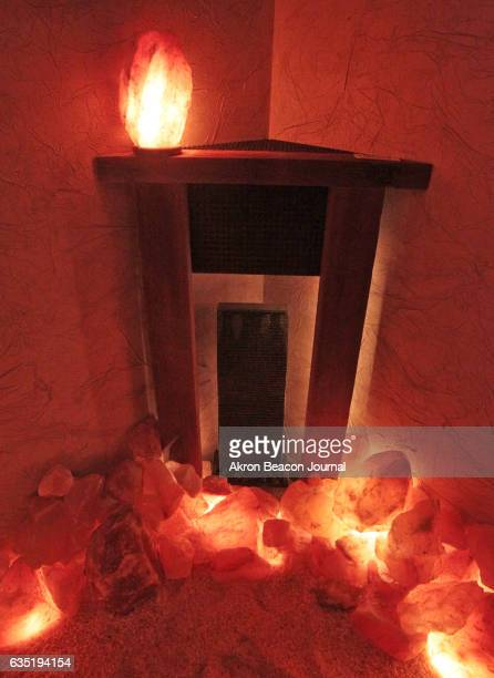A corner mantle piece frames a fountain in the salt cave at Caveation Himalayan salt experience at Rising Sun Holistic Choices on January 26 in...