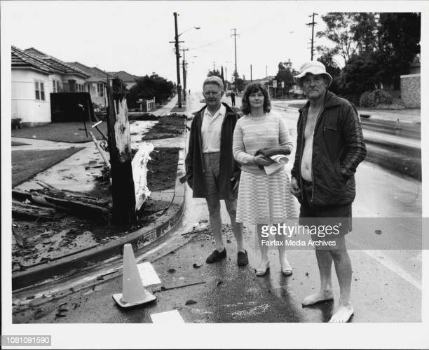 """Corner"""" - Mr. Edward Moule his daughter Mrs. Heather Watson and next-door neighbour Mr. Fred Stubberfield survey the debris outside their homes that..."""