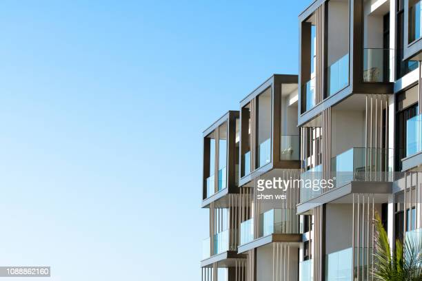 corner of an apartment building, dubai, uae - building exterior stock pictures, royalty-free photos & images