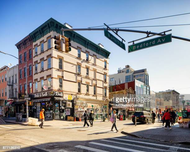 corner of bedford and 7th street in williamsburg brooklyn - williamsburg new york city stock pictures, royalty-free photos & images