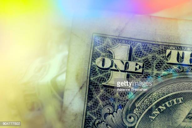 Corner of dollar bill with colorful prism effects