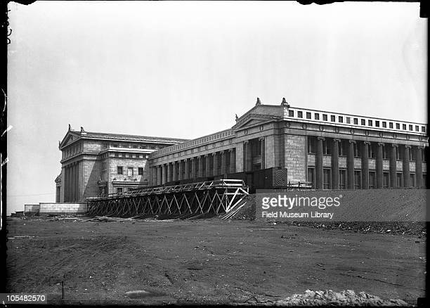 Corner of new Field Museum building showing railroad car with spiral at end Train tracks used in move from Field Columbian Museum Museum move series...