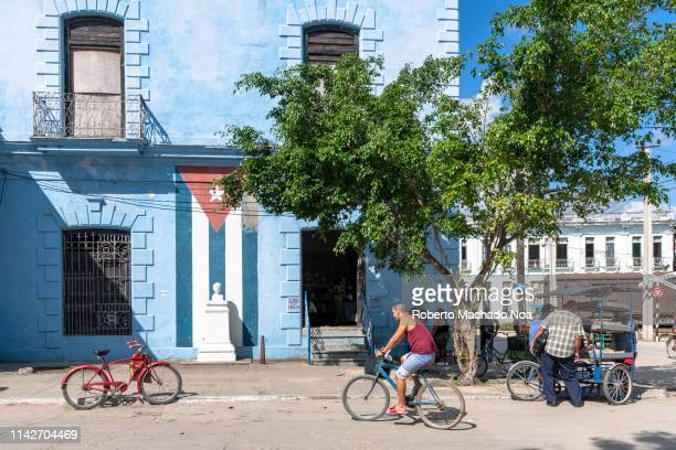 A corner of the intermunicipal bus station located on an old building A Cuban flag is painted on the wall The Jose Marti bust is in front of it The...