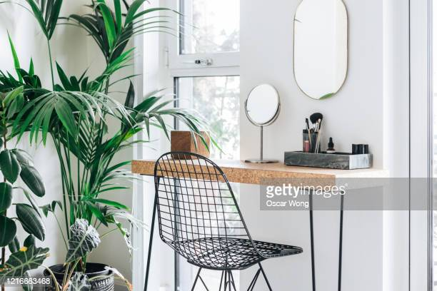 a corner of the modern, stylish and bright bedroom with plants - scandinavia stock pictures, royalty-free photos & images