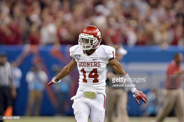Cornerback Aaron Colvin of the Oklahoma Sooners celebrates a first half lead against the Alabama Crimson Tide during the Sooners' win in the BCS...