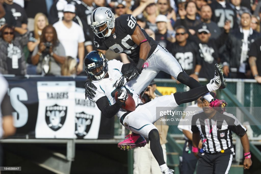 Cornerback Aaron Ross #31 of the Jacksonville Jaguars breaks up a pass intended for wide receiver Rod Streater #80 of the Oakland Raiders during the fourth quarter at O.co Coliseum on October 21, 2012 in Oakland, California. The Oakland Raiders defeated the Jacksonville Jaguars 26-23 in overtime. Photo by Jason O. Watson/Getty Images)
