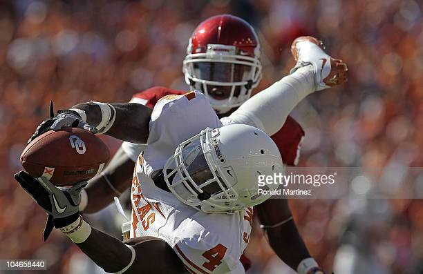 Cornerback Aaron Williams of the Texas Longhorns drops a pass intended for Ryan Broyles of the Oklahoma Sooners in the second quarter at the Cotton...