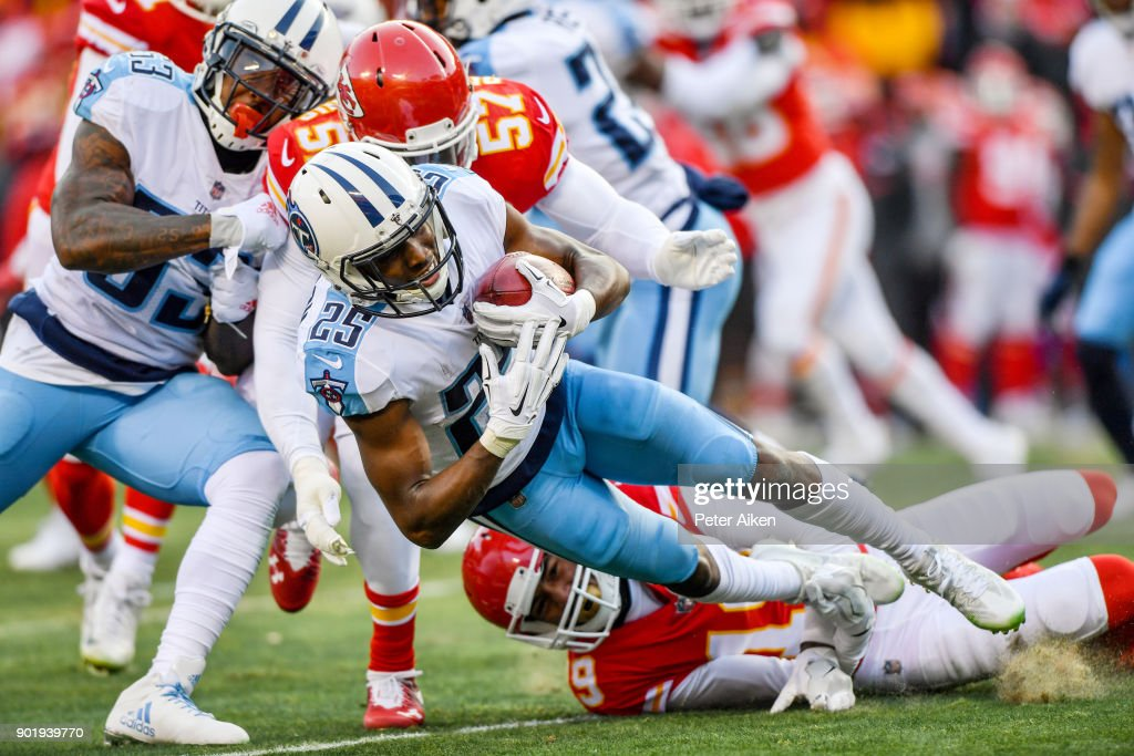 Cornerback Adoree' Jackson #25 of the Tennessee Titans is tackled by linebacker Kevin Pierre-Louis #57 and strong safety Daniel Sorensen #49 of the Kansas City Chiefs during the first quarter of the AFC Wild Card playoff game at Arrowhead Stadium on January 6, 2018 in Kansas City, Missouri.
