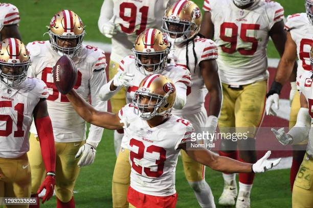 Cornerback Ahkello Witherspoon of the San Francisco 49ers celebrates with teammates after intercepting the ball in the end zone during the second...
