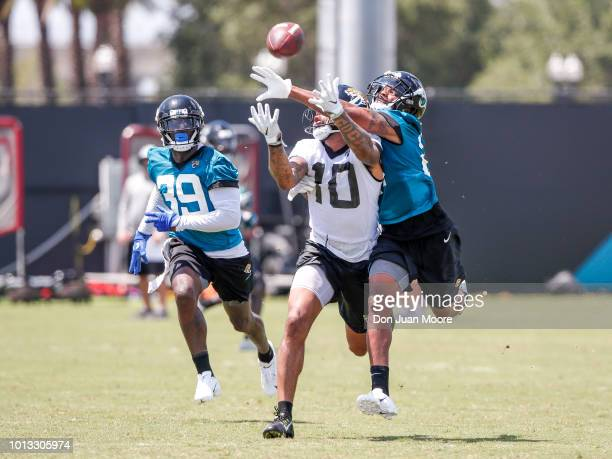 Cornerback AJ Bouye breaks up a pass for Wide Receiver Donte Moncrief of the Jacksonville Jaguars during Training Camp at Dream Finders Homes...